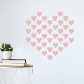 Autocollant mural à motif de coeurs