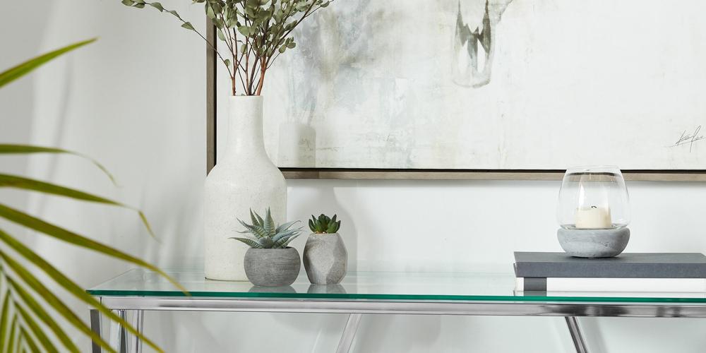 Grand porte-chandelle en verre et en ciment