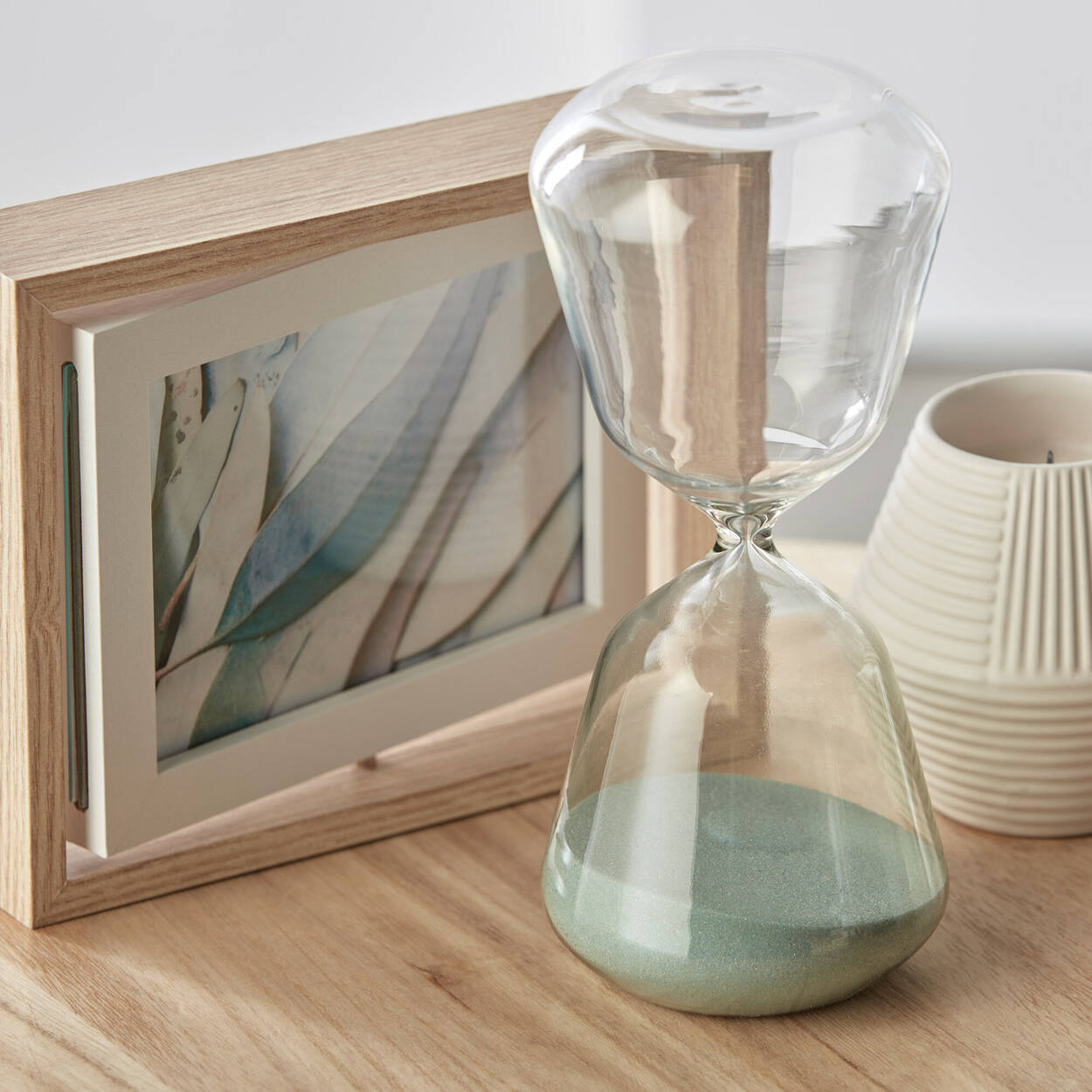 Decorative Hourglass with Aqua Sand 18 x 20 cm.