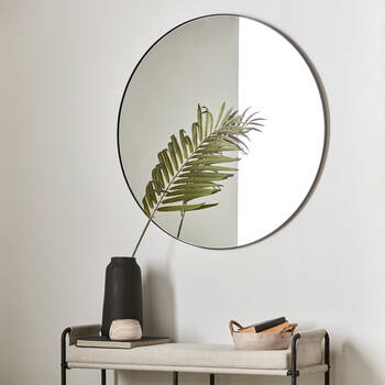 Miroir rond avec cadre noir