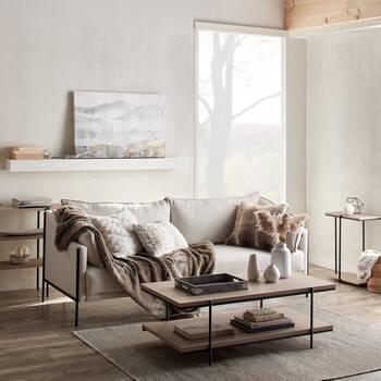 Sofa en tissu avec pattes en métal noires