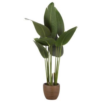 Grande plante artifielle dans un pot en bois